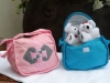 Animals - Koala bears in a carry bag