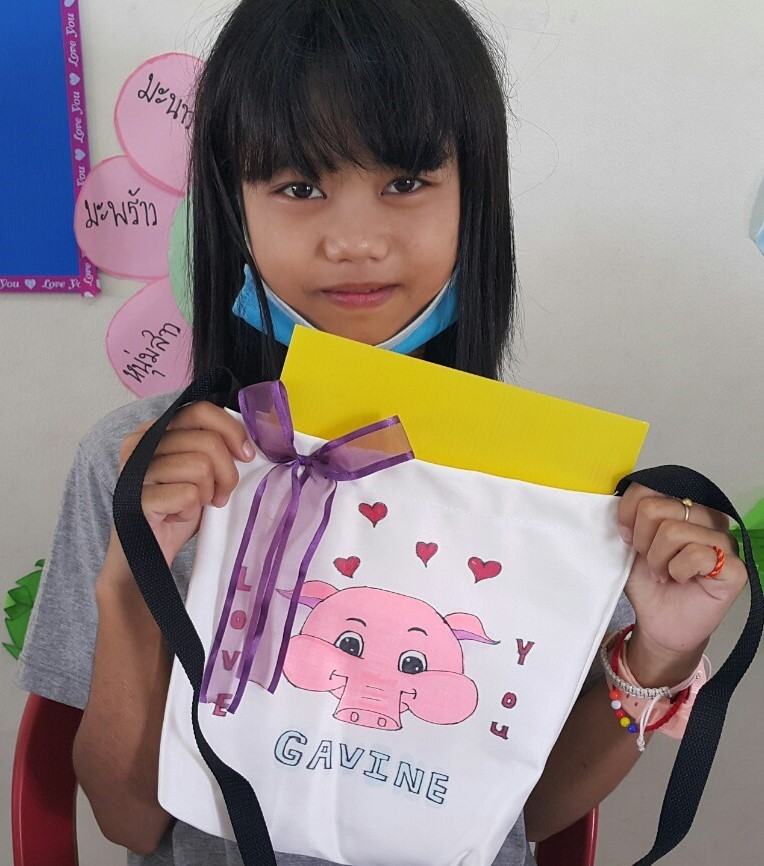 Young students learn and practice basic sewing and craft skills.